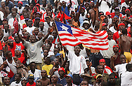 Fans sing and wave flags in the opening moments of the match.