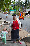 Grandmother with 17 month old daughter of food subject in Ban Phanluang, across the Nam Khan River from Luang Prabang, Laos.