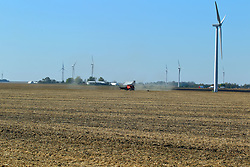 2017 Harvest is in full swing with crops coming out of the fields and tractors, semis, grain trucks, wagons and combines parked an moving about as needed to complete the task.