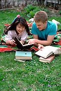 Japanese student & US host, age 18 studying English in his yard.  St Paul Minnesota USA
