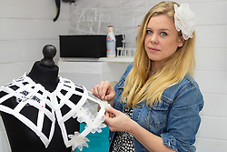 """Artist and Textile Designer Laura Marsden in her studio at the bottom of the garden of her St Albans, Herts, home creates exquisite """"Eternal Lace"""" fashion accessories, intricately woven from up-cycled plastic bags, bubble wrap and used Nespresso coffee pods. St Albans, Hertfordshire, May 01 2019."""