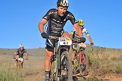 ROBERTSON, SOUTH AFRICA - MARCH 20: Karl Platt ahead of Luis Leao Pinto and Fabian Rabensteiner during stage two's 110km from Robertson on March 20, 2018 in Cape Town, South Africa. Mountain bikers from across South Africa and internationally gather to compete in the 2018 ABSA Cape Epic, racing 8 days and 658km across the Western Cape with an accumulated 13 530m of climbing ascent, often referred to as the 'untamed race' the Cape Epic is said to be the toughest mountain bike event in the world. (Photo by Dino Lloyd)