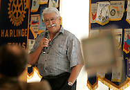 """Photo by Alex Jones..Al Garza, leader of the Minuteman Project, addresses a crowd gathered at a meeting of the Rotary Club at the Harlingen Country Club on Friday afternoon.  Garza, who spoke at length about the project's history and its plans to start patrolling the Rio Grande Valley, said that he is not anti-immigration.  """"There's a main door that you enter through -- just stop and sign the guestbook.  That's all we ask."""""""