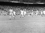 Roscommon kicks the ball towards the goal as an Armagh player jumps with hands held high in order to block it during the All Ireland Senior Gaelic Football Semi Final Replay Roscommon v Armagh in Croke Park on the 28th August 1977. Armagh 0-15 Roscommon 0-14.