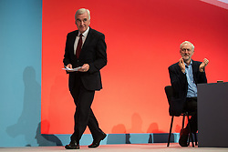 © Licensed to London News Pictures . 28/09/2015 . Brighton , UK . JOHN MCDONALD , shadow chancellor , applauded by JEREMY CORBYN , speaks at the 2015 Labour Party Conference . Photo credit : Joel Goodman/LNP