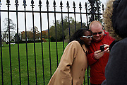 Pittsburgh residents Sonya Marie Morley and her husband Nathaniel Morley look at the photo they just had taken in front of the White House on Nov. 7, 2012, the day after President Barack Obama was declared the winner of the 2012 Presidential Election.