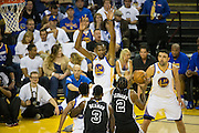 Golden State Warriors forward Kevin Durant (35) attempts to block a shot against the San Antonio Spurs at Oracle Arena in Oakland, Calif., on October 25, 2016. (Stan Olszewski/Special to S.F. Examiner)