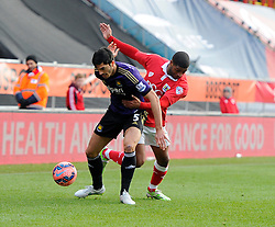 Bristol City's Mark Little battles for the ball with West Ham's James Tomkins  - Photo mandatory by-line: Joe Meredith/JMP - Mobile: 07966 386802 - 25/01/2015 - SPORT - Football - Bristol - Ashton Gate - Bristol City v West Ham United - FA Cup Fourth Round