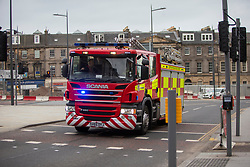 Fire engine on Leith ST. Edinburgh city centre on Tuesday 25th March, after the Lockdown.
