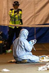 © Licensed to London News Pictures. 10/07/2015. London, UK. Forensic officers investigating a crime scene on Lordship Lane in Wood Green, north London where a man has died and a woman has been taken to hospital following an apparent drive-by shooting on Friday, July 10, 2015. Photo credit: Tolga Akmen/LNP