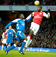 Photo: Ed Godden/Sportsbeat Images.<br /> Arsenal v Wigan Athletic. The Barclays Premiership. 11/02/2007. Wigan's Emile Heskey (L), chases after Johan Djourou.
