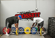 """BEAUFORT, SC - JULY 14: CJ Cummings, right, clean up at Cross Fit Beaufort after practices with weightlifting coach Ray Jones on July 14, 2014 in Beaufort, South Carolina. A former U.S. Olympic coach has called Cummings """"the best weightlifter this country has ever seen."""" (Photo by Stephen B. Morton for The Washington Post)"""
