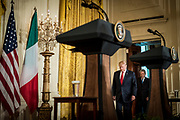 President Donald Trump arrive for a joint press conference with Prime Minister Paolo Gentiloni of Italy in the East Room of the White House in Washington, District of Columbia, U.S., on Thursday, April 20, 2017. Trump and Gentiloni are meeting ahead of the G-7 industrialized nations meeting in Italy next month.