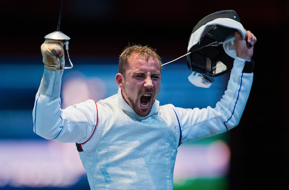 Victor Sintes of France celebrated his victory over Kenta Chida of Japan in the round of 32 in men's individual foil at the ExCel centre during the 2012 Summer Olympic Games in London, England, Tuesday, July 31, 2012. (David Eulitt/Kansas City Star/MCT)