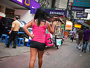 05 JULY 2011 - BANGKOK, THAILAND:   A Thai woman walks down Soi Arab towards Sukhumvit Road and Bangkok's adult entertainment district. Soi Arab is an alleyway in Bangkok. What started as an alley has now grown into a neighborhood that encompasses several blocks of restaurants, hotels and money exchanges that cater to Middle Eastern visitors to Thailand. The official name of the street is Sukhumvit Soi 3/1, located in North Nana between Sukhumvit Soi 3 and Sukhumvit Soi 5, not far from the Nana Plaza night-life area and the Grace Hotel popular among Arabs.   PHOTO BY JACK KURTZ