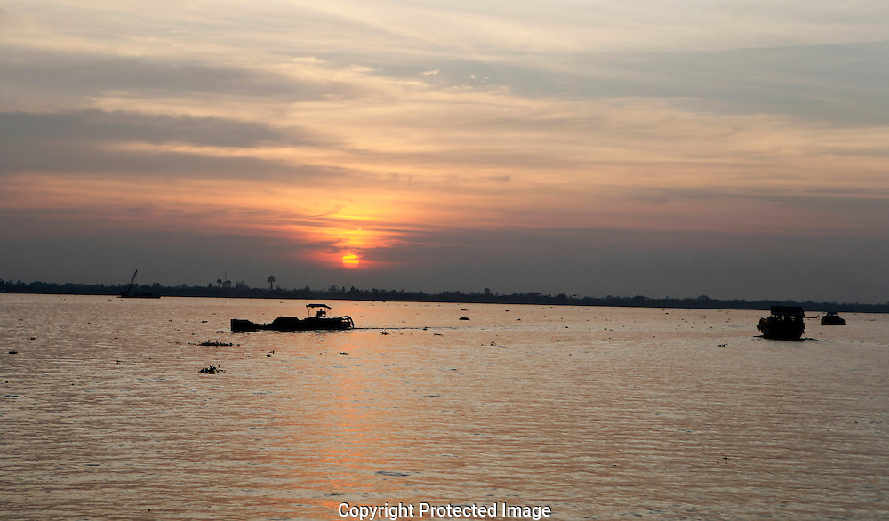 A sunset  along the Mekong River in Vietnam<br /> <br />  photo by Dennis Brack