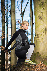 Young woman stretching on fitness trail