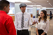 Purchase, NY – 31 October 2014. Saunders Trades and Technical High School students Paul Huitz and Gabriella Perez work on their presentation as team member Andrew Cardenas looks on. The Business Skills Olympics was founded by the African American Men of Westchester, is sponsored and facilitated by Morgan Stanley, and is open to high school teams in Westchester County.