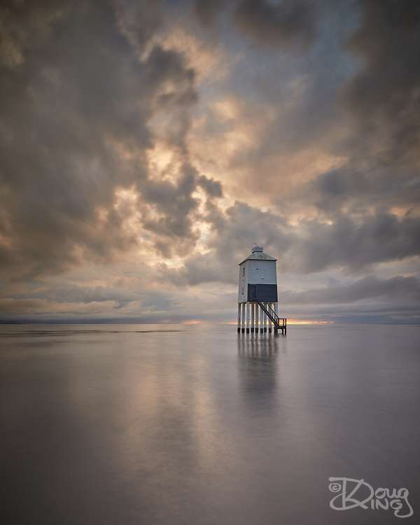 The low lighthouse at Burnham on Sea stands alone on the sands and is surrounded at high tides.