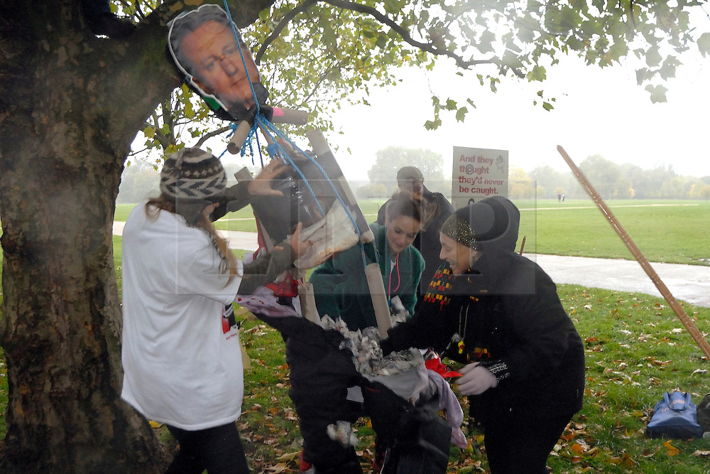 "© LONDON NEWS PICTURES 2010. 26/10/2010, Mental health service users at speakers corner, Hyde Park, London hang, draw, quarter and burn an effigy of Prime Minister David Cameron in protest at the cuts to services and benefits to come. ..""All UK mental health sercie users will default on their medication for one day, in protest against the coming savage welfare benefits cuts. Further, all UK service users will not engage with any mental health services whatsoever on that dat, in a bid to demonstrate our power.""©London News pictures..."