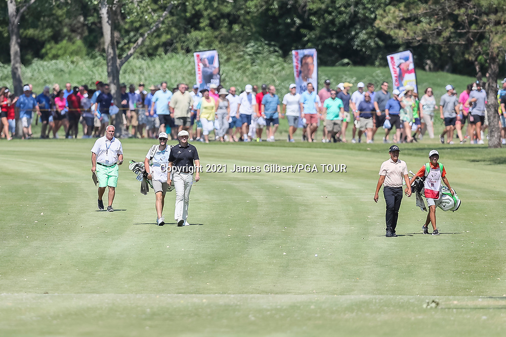 WICHITA, KS - JUNE 20: Harry Hall of England and Kevin Yu of Chinese Taipei walk to the 18th green during the final round of the Wichita Open Benefitting KU Wichita Pediatrics at Crestview Country Club on June 20, 2021 in Wichita, Kansas. (Photo by James Gilbert/PGA TOUR via Getty Images)