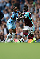 Football - Raheem Sterling of Manchester City and Arthur Masuaku of West Ham during the match at the Etihad Stadium between Manchester City and West Ham United. <br /> <br /> 2016 / 2017 Premier League - Manchester City vs. West Ham United<br /> <br /> -- at The Etihad Stadium.<br /> <br /> COLORSPORT/LYNNE CAMERON