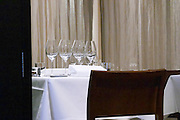 Table set with starched linen table cloth, napkins, and wine glasses. Vassa Eggen gastronomic restaurant. Stockholm. Sweden, Europe.