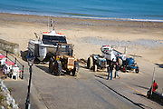 Tractors and fishing boats on the beach, Cromer, Norfolk, England
