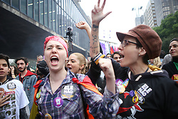October 6, 2018 - Sao Paulo, Brazil - Protesters and members of collective and social movements participate in the second protest against presidential candidate Jair Bolsonaro (PSL), on the eve of the first round of elections, on Avenida Paulista on October 06, 2018. (Credit Image: © Dario Oliveira/NurPhoto/ZUMA Press)