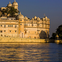 Udaipur's City Palace is set ablaze in the light of the setting sun.  Rajasthan, India.