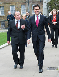 (L-R) Newly Elected MP for Wythenshawe and Sale East Mike Kane MP arriving with Labour leader Ed Miliband outside of The House of Commons on College Green, London, UK with members of the Labour party behind.<br /> Monday, 24th February 2014. Picture by Elliott Franks / i-Images