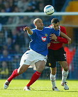 Fotball<br /> Premier League England 2004/2005<br /> Foto: BPI/Digitalsport<br /> NORWAY ONLY<br /> <br /> 30.10.2004<br /> Portsmouth v Manchester United<br /> <br /> Nigel Quashie battles with Ryan Giggs