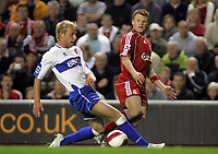 Photo: Paul Thomas.<br /> Liverpool v Middlesbrough. The Barclays Premiership. 18/04/2007.<br /> <br /> John Arne Riise (R) passes past Andrew Davies of Boro.