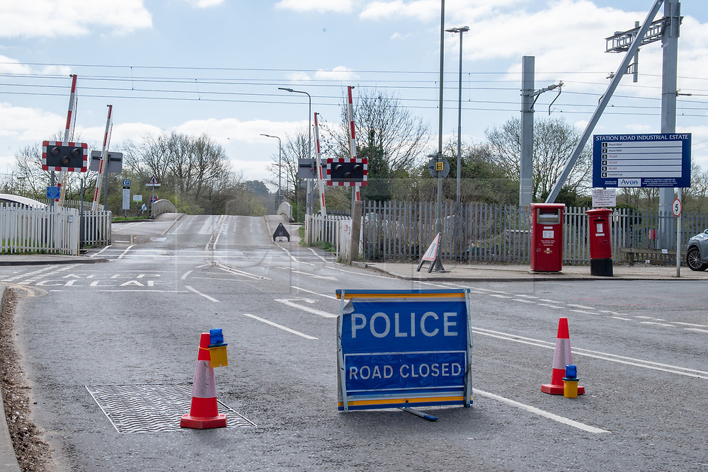 © Licensed to London News Pictures. 02/04/2021. Thatcham, UK. A police road closed sign on Station Road near the Thatcham train station after a woman, aged in her forties, was found with significant injuries in Crookham Hill, Crookham Common at approximatly 11:45pm on Thursday 01/04/2021 and died from her injuries. A man, aged 35, has been arrested on suspicion of murder. Photo credit: Peter Manning/LNP
