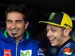 October 21, 2017 - Melbourne, Victoria, Australia - Italian rider Valentino Rossi (#46) of Movistar Yamaha MotoGP (R) has a laugh with his data engineer Matteo Flamigni (L) before the third free practice session at the 2017 Australian MotoGP at Phillip Island, Australia. (Credit Image: © Theo Karanikos via ZUMA Wire)