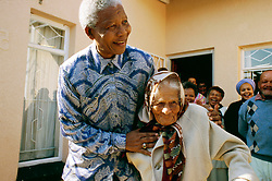 NELSON ROLIHLAHLA MANDELA (July 18, 1918 - December 5, 2013), 95, world renown civil rights activist and world leader. Mandela emerged from prison to become the first black President of South Africa in 1994. As a symbol of peacemaking, he won the 1993 Nobel Peace Prize. Joined his countries anti-apartheid movement in his 20s and then the ANC (African National Congress) in 1942. For next 20 years, he directed a campaign of peaceful, non-violent defiance against the South African government and its racist policies and for his efforts was incarcerated for 27 years. Remained strong and faithful to his cause, thru out his life, of a world of peace. Transforming the world, to make it a better place. PICTURED: Kliptown, Soweto, South Africa - President NELSON MANDELA hugs a woman whose family hid him when he was on the run and known as 'The Black Pimpernel' before his arrest ahead of the Rivonia Trial that saw him sentenced to 27 years in jail before emerging to become the first democratic president. (Credit Image: © Greg Marinovich/ZUMA Wire/ZUMAPRESS.com)