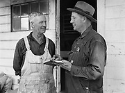 5578Camp carpenter, E. S. Farley, with the camp Marshall, E. S. Stultz at the E. Clemens Horst hop ranch near Independence, Oregon. September 1, 1942.