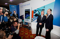 © London News Pictures. 04/11/2013 . London, UK.  The Confederation of British Industry (CBI) President Sir Michael Rake (second right) stands with Director General of the CBI John Cridland (right) at a photo call for the opening of the 2013 Confederation of British Industry (CBI) Conference, held at the Hilton Metropole in London. Photo credit : Ben Cawthra/LNP