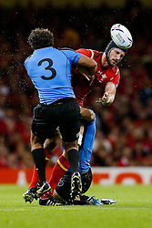Wales Lock Luke Charteris spills the ball as he is tackled by Uruguay Prop Mario Sagario and Lock Jorge Zerbino - Mandatory byline: Rogan Thomson/JMP - 07966 386802 - 20/09/2015 - RUGBY UNION - Millennium Stadium - Cardiff, Wales - Wales v Uruguay - Rugby World Cup 2015 Pool A.