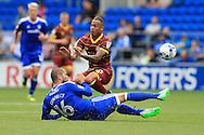 Tjarron Chery of Queens Park Rangers is tackled by Mathew Connolly of Cardiff city. EFL Skybet championship match, Cardiff city v Queens Park Rangers at the Cardiff city stadium in Cardiff, South Wales on Sunday 14th August 2016.<br /> pic by Andrew Orchard, Andrew Orchard sports photography.