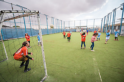 20 February 2020, Za'atari Camp, Jordan: A girl shoots a free kick on goal during football practice for girls in the Peace Oasis, a Lutheran World Federation space in the Za'atari Camp where Syrian refugees are offered a variety of activities on psychosocial support, including counselling, life skills trainings and other activities.