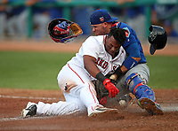 Boston RedSox Rafael divers collides with Cubs Victor Caratini during a game on March 26,2018.<br /> (Photo/Tom DiPace)