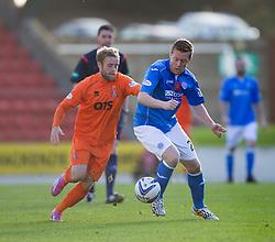Kilmarock's Rory McKenzie and St Johnstone's Scott Brown.<br /> St Johnstone 1 v 2 Kilmarock, SPL game played at McDrarmid Park.