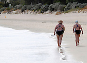 AUSTRALIA - BANBURY Two women swimmers stroll along the beech at Banbury, Western Australia. 10/01/2010. STEPHEN SIMPSON...