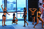 Contestants warm up before competing in the final round of the SeaGal auditions Sunday, May 24, 2016, at CenturyLink Field in Seattle. More than 200 first round women were culled down to 49 to compete in the final round of auditions for a place on the 2016 squad of Seattle Seahawks cheerleaders.  (Genna Martin, seattlepi.com)