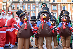 © Licensed to London News Pictures. 02/12/2017. London, UK. Participants take part in The 37th Great Christmas Pudding Race in Covent Garden, raising funds for Cancer Research as well as having a lot of festive fun.  Photo credit: Stephen Chung/LNP