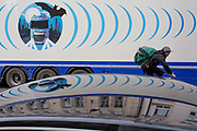 The design on the side of an HGV for the rehearsal studio company Fly By Nite and a passing cyclist in Great Marlborough Street, on 5th March 2019, in London, England.