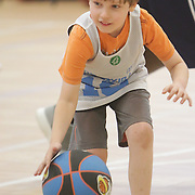 George Kouminow dribbles during Halo Basketball Saturday December 20, 2014 at Grace United Methodist Church in Wilmington, N.C. (Jason A. Frizzelle)