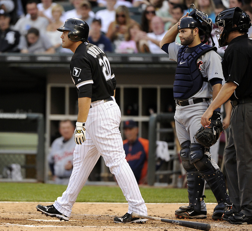CHICAGO - JUNE 04:  Carlos Quentin #20 of the Chicago White Sox glares toward Justin Verlander #35 of the Detroit Tigers after being hit by a pitch on June 4, 2011 at U.S. Cellular Field in Chicago, Illinois.  The Tigers defeated the White Sox 4-2.  (Photo by Ron Vesely)  Subject:  Carlos Quentin;Adam Dunn