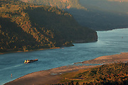 Barge on the Columbia River in the Columbia Gorge at sunset, Oregon.